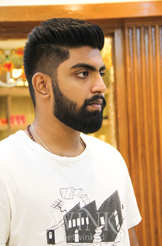 Fade Haircut with well trimmed beard